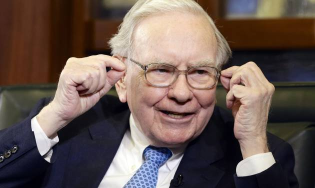 Berkshire Hathaway Chairman and CEO Warren Buffett gestures during an interview with Liz Claman on the Fox Business Network in Omaha, Neb., Monday, May 5, 2014. The annual Berkshire Hathaway shareholders meeting concluded over the weekend. (AP Photo/Nati Harnik)