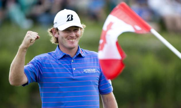 Brandt Snedeker, right, of the United States, celebrates after winning the Canadian Open golf tournament at Glen Abbey in Oakville, Ontario, Sunday, July 28, 2013. (AP Photo/The Canadian Press, Nathan Denette)