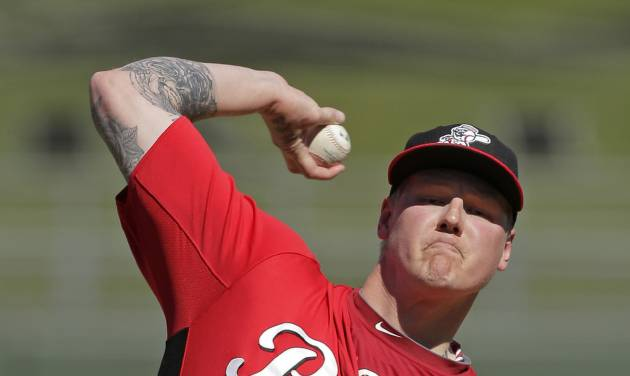 Cincinnati Reds starting pitcher Mat Latos throws during the second inning of an exhibition spring training baseball game against the Kansas City Royals, Friday, March 1, 2013, in Surprise, Ariz. (AP Photo/Charlie Riedel)