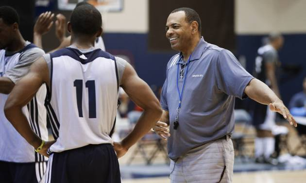 Memphis Grizzlies head coach Lionel Hollins, right, talks with guard Mike Conley (11) during NBA basketball training camp on Tuesday, Oct. 2, 2012, in Memphis, Tenn. (AP Photo/Mark Humphrey)