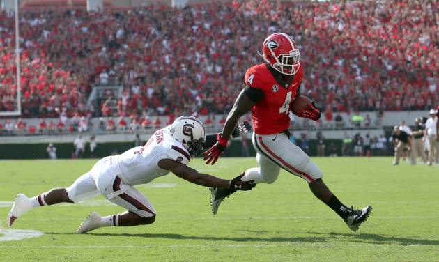 Georgia tailback Keith Marshall scores on a 6-yard pass from quarterback Aaron Murray past South Carolina defender Ahmad Christian (4) in the first half of an NCAA college football game Saturday, Sept. 7, 2013, in Athens, Ga. Georgia won 41-30. (AP Photo/Atlanta Journal Constitution, Jason Getz) GWINNETT OUT  MARIETTA OUT   LOCAL TV OUT (WXIA, WGCL, FOX 5)