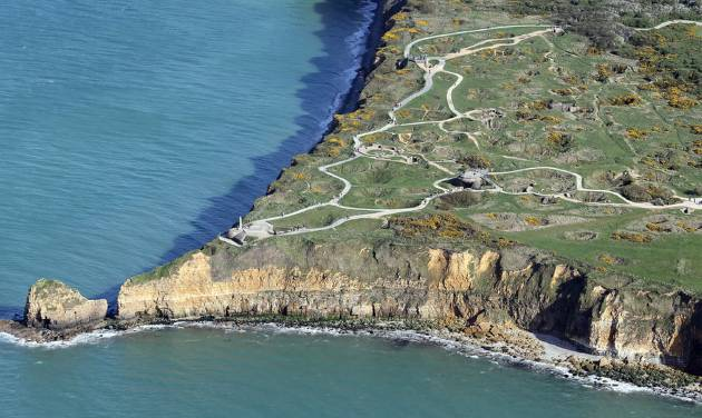 "The ""Pointe du Hoc"" is pictured Tuesday, April 8, 2014 near Caen, Normandy, France. It was the highest point during WWII between Utah Beach and and Omaha Beach. The Germans fortified the area with concrete bunkers and gun pits. On D-Day (June 6, 1944) the United States Army successfully assaulted Point du Hoc after scaling the cliffs. France is preparing to mark the 70th anniversary of the D-Day invasion which took place on June 6, 1944. (AP Photo/David Vincent)"