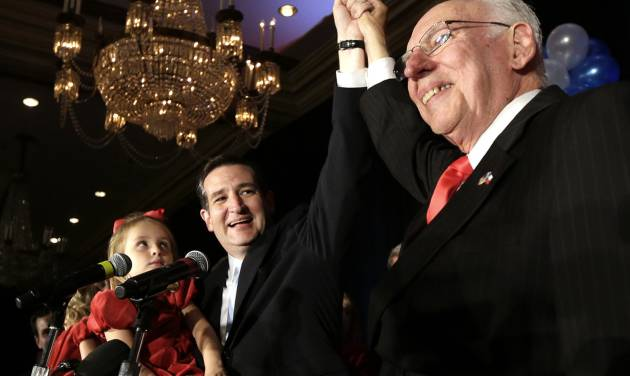 Republican candidate for U.S. Senate Ted Cruz, left, raises his hand with his father Rafael, right, while holding his daughter Caroline during a victory speech Tuesday, Nov. 6, 2012, in Houston. Cruz defeated Democrat Paul Sadler to replace retiring U.S. Sen. Kay Bailey Hutchison. (AP Photo/David J. Phillip)