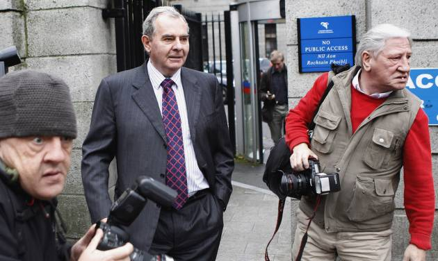 FILE This Friday, Oct. 19, 2012 file photo shows Sean Quinn leaving Dublin high court, Dublin, Ireland. A judge in Ireland on Friday Nov. 2, 2012 ordered bankrupt tycoon Sean Quinn jailed for nine weeks for failing to observe orders to stop placing foreign property assets beyond the reach of creditors. Quinn — Ireland's richest man until 2008 — faces financial ruin because of his reckless gamble that year on Anglo Irish Bank. The Dublin lender was the biggest financier of Ireland's runaway property market, a boom that imploded in 2009.(AP Photo/Peter Morrison, File )