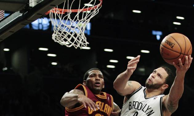 Brooklyn Nets' Deron Williams (8) drives past Cleveland Cavaliers' Alonzo Gee (33) during the first half of an NBA basketball game, Tuesday, Nov. 13, 2012, in New York. (AP Photo/Frank Franklin II)