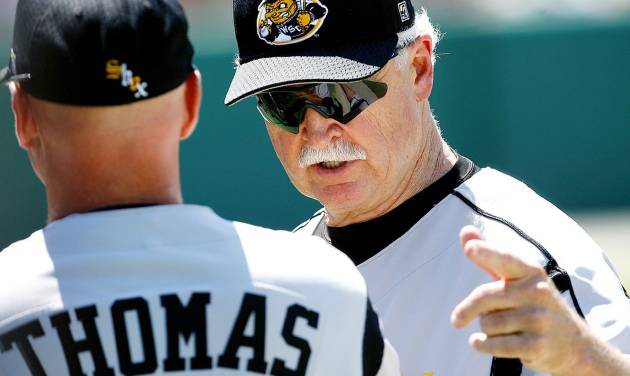 Wichita State University head coach Gene Stephenson (right) talks with assistant coach Jim Thomas between innings during their college baseball game against Houston at the 2006 NCAA Norman Regional at the University of Oklahoma's L. Dale Mitchell Park in Norman, Okla., Friday, June 2, 2006. Wichita State won the game 2-1. By John Clanton, The Oklahoman