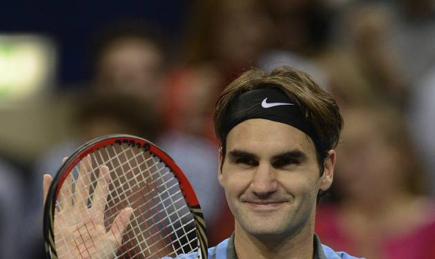 Switzerland's Roger Federer cheers after winning his semifinal match against France's Paul-Henri Mathieu at the Swiss Indoors tennis tournament at the St. Jakobshalle in Basel, Switzerland, on Saturday, Oct. 27, 2012. (AP Photo/Keystone/Georgios Kefalas)