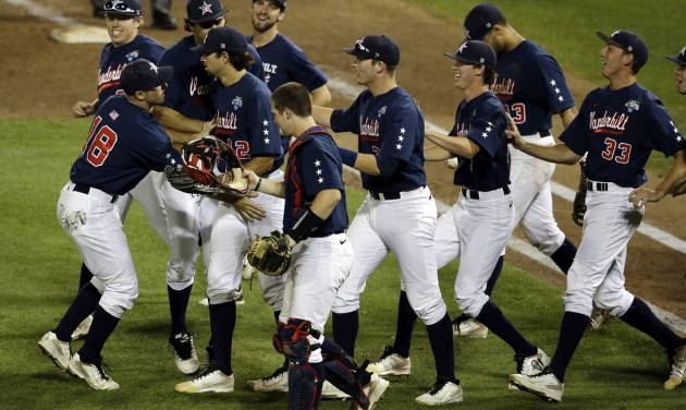 Vanderbilt players celebrate after Vanderbilt defeated Virginia 9-8 in the opening game of the best-of-three NCAA baseball College World Series finals in Omaha, Neb., Monday, June 23, 2014. (AP Photo/Nati Harnik)
