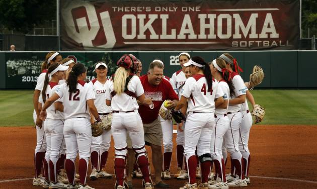 "Jim Routon, Moore tornado survivor and ""Big Dog"" in a photograph by Paul Hellstern that appeared following the deadly tornado, threw out the first pitch and celebrates with the team before the University of Oklahoma Sooner (OU) softball team plays Tennessee in the first game of the NCAA super regional at Marita Hynes Field on May 23, 2014 in Norman, Okla. Photo by Steve Sisney, The Oklahoman"