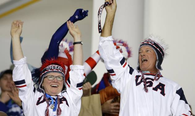 USA fans cheers during the 2014 Winter Olympics women's ice hockey game between Canada and the United States at Shayba Arena, Wednesday, Feb. 12, 2014, in Sochi, Russia. (AP Photo/Matt Slocum)