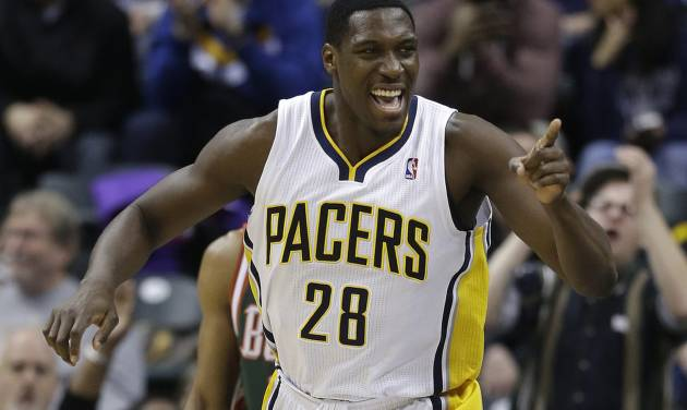 Indiana Pacers' Ian Mahinmi celebrates following a dunk during the first half of an NBA basketball game against the Milwaukee Bucks, Thursday, Feb. 27, 2014, in Indianapolis. (AP Photo/Darron Cummings)