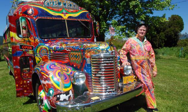 In a May 14, 2014 photo, Zane Kesey poses with the latest version of the psychedelic bus Further in Pleasant Hill, Ore. Kesey is raising money on Kickstarter to put the bus on the road to commemorate the 50th anniversary of the 1964 LSD-fueled bus trip by his late father, author Ken Kesey, and his pals, the Merry Pranksters. (AP Photo/Jeff Barnard) \