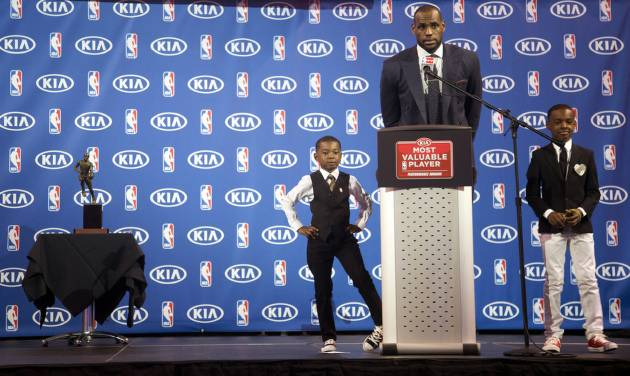 Miami Heat's LeBron James speaks as his sons Bryce, left, and LeBron Jr., stand by during an NBA basketball news conference, Sunday, May, 5, 2013, in Miami. James was formally announced as having won his fourth Most Valuable Player award Sunday. (AP Photo/J Pat Carter)