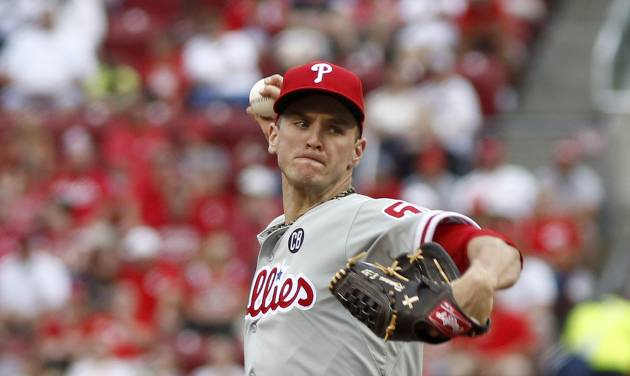 Philadelphia Phillies starting pitcher David Buchanan throws against the Cincinnati Reds during the first inning of a baseball game, Sunday, June 8, 2014, in Cincinnati. (AP Photo/David Kohl)