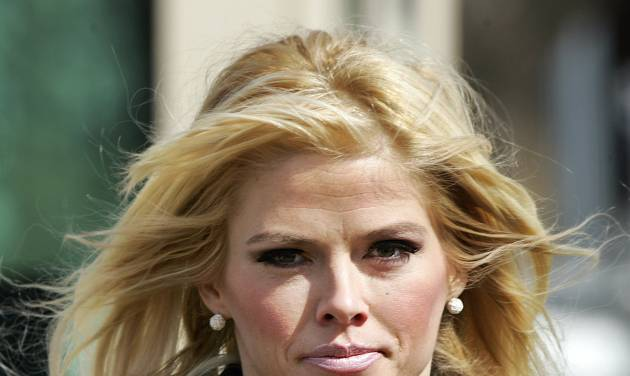 FILE - In this Feb. 28, 2006, file photo, Anna Nicole Smith, leaves the U.S. Supreme Court in Washington, D.C. Smith's final bid to obtain her late husband's money has failed, seven years after her death. A federal judge in Santa Ana, Calif., on Monday, Aug. 18, 2014, rejected a bid by Smith's estate to obtain about $44 million from the estate of J. Howard Marshall II, her late Texas billionaire husband. (AP Photo/Manuel Balce Ceneta, File)