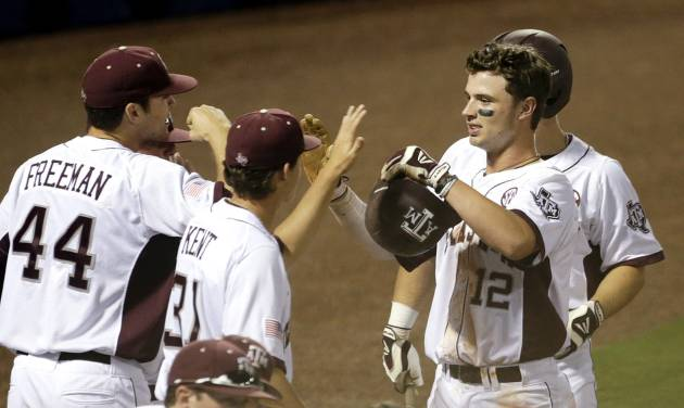 Texas A&M's Cole Lankford (12) is congratulated after scoring in the first inning of their Southeastern Conference Tournament NCAA college baseball game against Mississippi State at the Hoover Met in Hoover, Ala., Thursday, May 23, 2013. (AP Photo/Dave Martin)