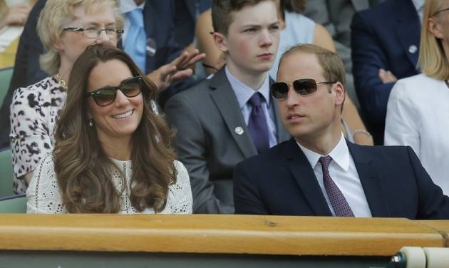 Britain's Prince William, right, and Kate, Duchess of Cambridge watch from the Royal Box on centre court during the men's singles quarterfinal match between Andy Murray of Britain and Grigor Dimitrov of Bulgaria at the All England Lawn Tennis Championships in Wimbledon, London, Wednesday, July 2, 2014. (AP Photo/Pavel Golovkin)