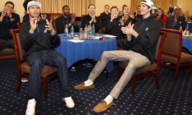 In this photo provided by the University of Kansas, Kansas guard Travis Releford, left, and center Jeff Withey react after learning their NCAA college basketball tournament assignment during a Selection Sunday viewing party, Sunday, March 17, 2013, in Lawrence, Kan. Kansas is scheduled to face Western Kentucky in the second round on Friday in Kansas City, Mo. (AP Photo/University of Kansas, Jeff Jacobsen) ORG XMIT: KSOW105