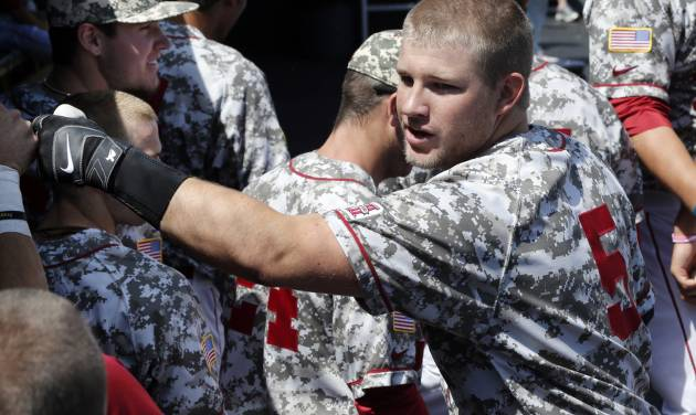Colt Bickerstaff is congratulated on his home run in the dugout as the University of Oklahoma (OU) Sooners play New Orleans in NCAA college baseball at L. Dale Mitchell Field on Saturday, April 20, 2013 in Norman, Okla.  Photo by Steve Sisney, The Oklahoman