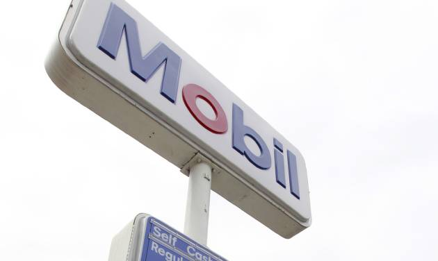In this Monday, Sept. 10, 2012 photo gasoline prices are displayed at a Mobil station in Needham, Mass. The price of oil fell slightly Monday after an unexpectedly weak economic report from China and warnings of a further slowdown. (AP Photo/Steven Senne)
