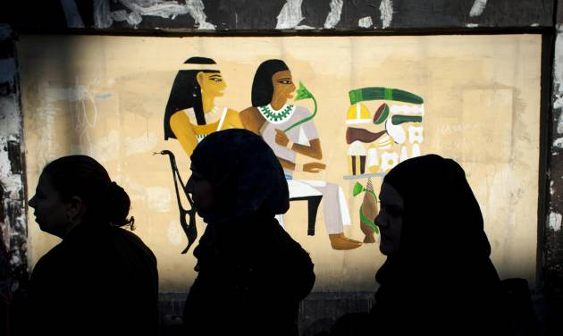 Egyptian women voters queue outside a polling station during the second round of a referendum on a disputed constitution drafted by Islamist supporters of president Mohammed Morsi, in Giza, Egypt, Saturday, Dec. 22, 2012. (AP Photo/Nasser Nasser)