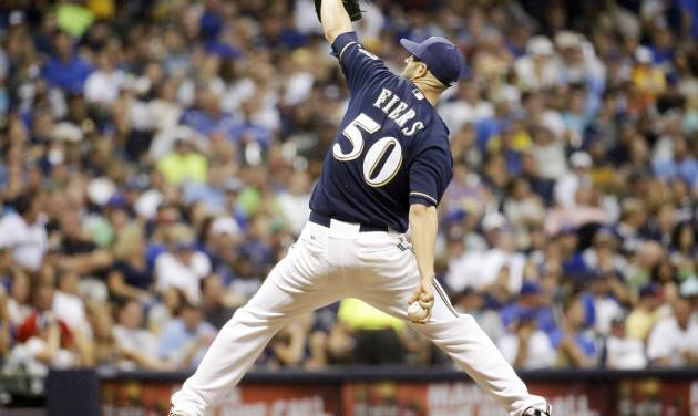 Milwaukee Brewers starting pitcher Mike Fiers throws during the seventh inning of a baseball game against the Toronto Blue Jays, Tuesday, Aug. 19, 2014, in Milwaukee. (AP Photo/Morry Gash)