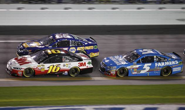 Greg Biffle (16), Martin Truex Jr. (56) and Kasey Kahne (5) race through the front stretch early in the NASCAR Sprint Unlimited auto race at Daytona International Speedway, Saturday, Feb. 16, 2013, in Daytona Beach, Fla. (AP Photo/Terry Renna)
