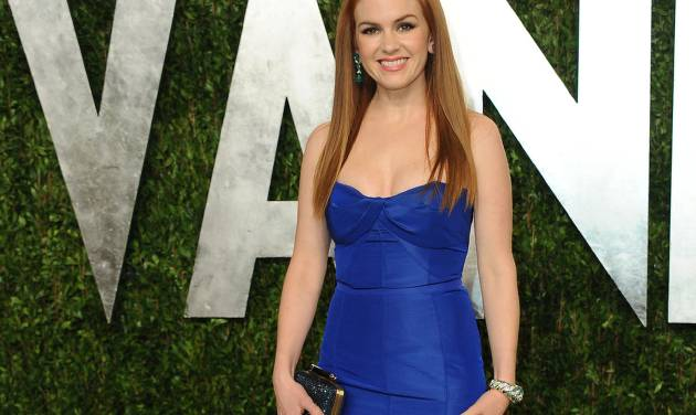"FILE - In this Feb. 24, 2013 file photo, actress Isla Fisher arrives at the 2013 Vanity Fair Oscars Viewing and After Party at the Sunset Plaza Hotel in West Hollywood, Calif.  Fisher appears in two of the first major films of the summer-movie season: the latest adaptation of F. Scott Fitzgerald's ""The Great Gatsby"" as well as the crime caper ""Now You See Me."" (Photo by Jordan Strauss/Invision/AP, File)"