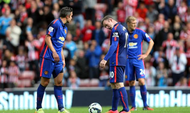Manchester United's captain Wayne Rooney, right, and Robin Van Persie, left, stand dejected after Sunderland's Jack Rodwell scores his goal during their English Premier League soccer match at the Stadium of Light, Sunderland, England, Sunday, Aug. 24, 2014. (AP Photo/Scott Heppell)