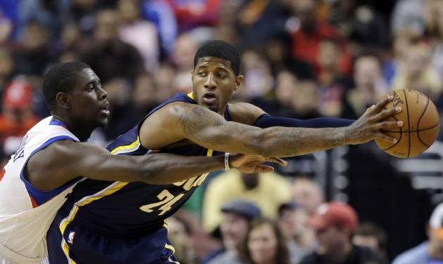 Indiana Pacers' Paul George, right, tries to keep the ball away from Philadelphia 76ers' Jrue Holiday during the first half of an NBA basketball game on Saturday, March 16, 2013, in Philadelphia. (AP Photo/Matt Slocum)