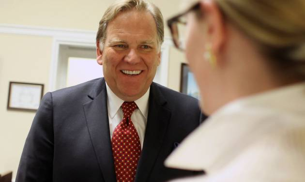 """In this April 30, 2014 photo, Rep. Mike Rogers, R-Mich, smiles in his office on Capitol Hill in Washington. The daily radio show Rogers begins hosting in January will give the Michigan Republican practice talking to millions of Americans every day, and honing what he calls a """"productive conservative"""" message talk radio is desperately lacking, he said. (AP Photo/Lauren Victoria Burke)"""