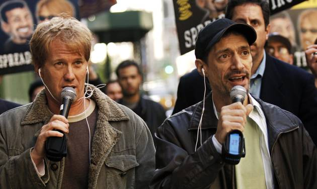 "FILE - In a April 26, 2006 file photo, radio shock jocks Greg ""Opie"" Hughes, left, and Anthony Cumia, right, leave CBS Radio studios on 57th Street with fans after finishing their first morning show, in New York.  Cumia of the ""Opie & Anthony"" radio show was fired late Thursday, July 3, 2014 by SiriusXM, who cited his ""racially charged"" and ""hate-filled"" remarks on Twitter as the reason. (AP Photo/ Louis Lanzano, File)"