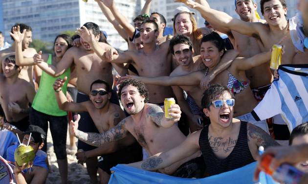 Argentina soccer fans cheer on Copacabana beach the morning of the final World Cup match between Argentina and Germany in Rio de Janeiro, Brazil, Sunday, July 13, 2014. (AP Photo/Silvia Izquierdo)