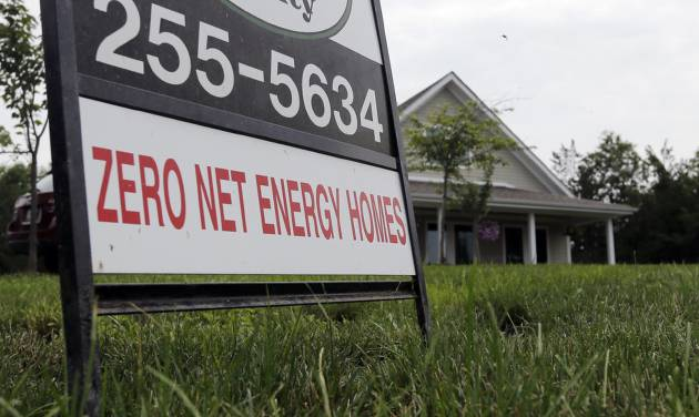 In this Tuesday, July 9, 2013, photo,  a zero net energy home is listed for sale in New Paltz, N.Y. Freddie Mac reports on mortgage rates for the last week on Thursday, July 18, 2013. (AP Photo/Mike Groll)