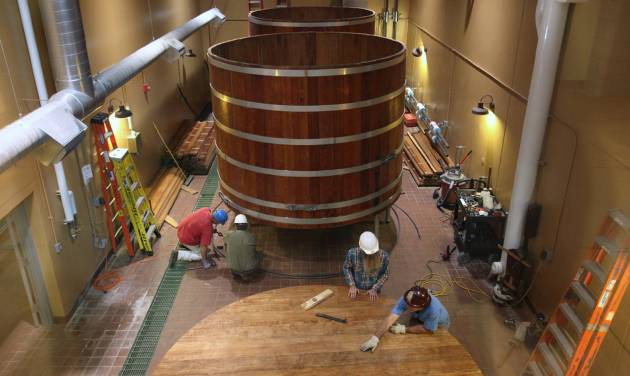 FILE - In this Aug. 15, 2013, file photo, Three 100-year-old fermentation barrels from Detroit's Stroh's brewery are assembled at Bell's Brewery in Comstock for making lager beer, in Kalamazoo, Mich. Bell's Brewery said it plans to open a new pub the week of Monday, Sept. 16, 2013, at Gerald Ford International Airport in Grand Rapids. It will be similar to but smaller than Bell's Eccentric Cafe in Kalamazoo. (AP Photo/Kalamazoo Gazette/m.live media group, Mark Bugnaski, File)