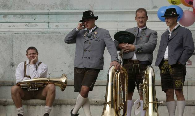 Musicians of the Oktoberfest orchestra await the start of the famous Oktoberfest beer festival concert in Munich, southern Germany, Sunday, Sept. 30, 2012. The world's largest beer festival, to be held from Sept. 22 to Oct. 7, 2012 will see some million visitors. (AP Photo/Matthias Schrader)