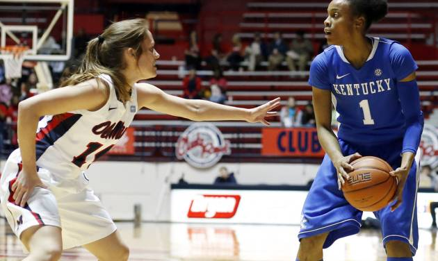 Kentucky guard A'dia Mathies (1) looks to move against Mississippi guard Maggie McFerrin (14) during the first half of an NCAA college basketball game in Oxford, Miss., Thursday, Feb. 28, 2013. No. 10 Kentucky won 90-65. (AP Photo/Rogelio V. Solis)