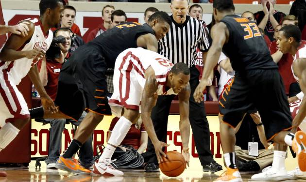 BEDLAM / OKLAHOMA STATE UNIVERSITY: Sooners' Amath M'Baye (22) gets a loose ball in front of Cowboys' Le'Bryan Nash (2) during the second half as the University of Oklahoma Sooners (OU) defeat  the Oklahoma State Cowboys (OSU) 77-68  in NCAA, men's college basketball at The Lloyd Noble Center on Saturday, Jan. 12, 2013  in Norman, Okla. Photo by Steve Sisney, The Oklahoman