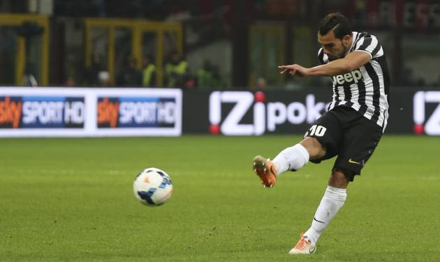 Juventus forward Carlos Tevez, of Argentina, scores during a Serie A soccer match between AC Milan and Juventus, at the San Siro stadium in Milan, Italy, Sunday, March 2, 2014. (AP Photo/Luca Bruno)