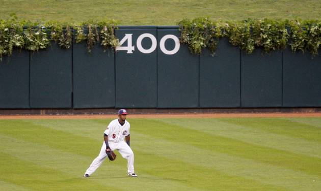 """RedHawks center fielder Julio Borbon patrols the outfield at AT&T Bricktown Ballpark, which has ivy on the walls like Chicago's Wrigley Field as part of the club's """"Taste of the Big Leagues"""" campaign. Photo by Doug Hoke, The Oklahoman"""