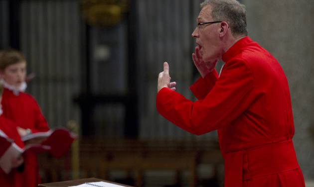 James O'Donnel directs the Choir of the Westminster Abbey as they perform during a concert of Sacred Choral Music, in the St. Mary Major basilica, in Rome, Wednesday, June 27, 2012. The Westminster Abbey Choir, the world-renown chorus which last year performed at the wedding of Prince William and Kate Middleton, will join the Sistine singers at a special papal Mass on Friday in St. Peter's Basilica, a historic event seen as a perfect symbol of Christian harmony _ after centuries of discord. It's the first time in its 500-plus year history that the pope's personal choir will be accompanied by another chorus, let alone one that comes from the breakaway Anglican Church. (AP Photo/Andrew Medichini)