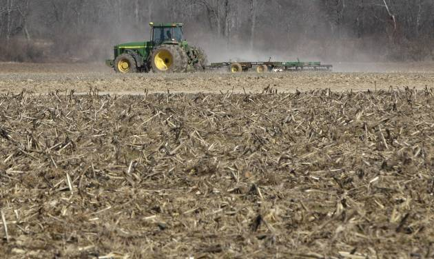 FILE - This Jan. 30, 2014 file photo shows a farmer taking advantage of dry weather to till a field in preparation for spring planting near England, Ark. Congress has given its final approval to a sweeping five-year farm bill that provides food for the needy and subsidies for farmers. Ending years of political battles, the Senate vote Tuesday sends the measure to President Barack Obama, who is expected to sign it.  (AP Photo/Danny Johnston, File)