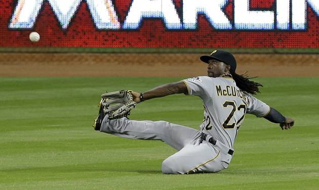 Pittsburgh Pirates center fielder Andrew McCutchen prepares to catch a line drive by Miami Marlins' Rafael Furcal in the fifth inning of a baseball game in Miami, Saturday, June 14, 2014. (AP Photo/Alan Diaz)