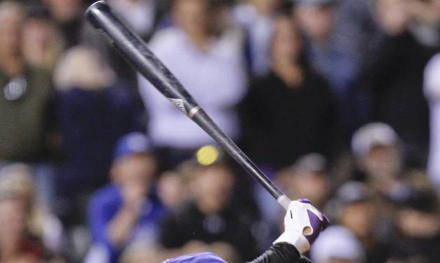 Colorado Rockies left fielder Carlos Gonzalez (5) slams his bat down into the ground after striking out to end the game during the ninth inning of a baseball game Tuesday, May 1, 2012 in Denver. The Los Angeles Dodgers won 7-6. (AP Photo/Barry Gutierrez)