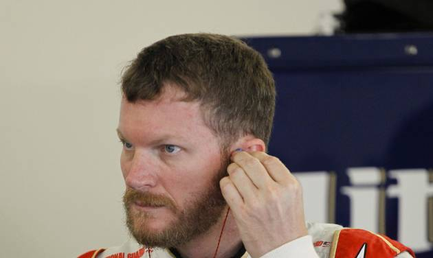 Dale Earnhardt Jr. prepares to get in his car during a NASCAR Sprint Cup practice session at Daytona International Speedway in Daytona Beach, Fla., Thursday, July 3, 2014. (AP Photo/Terry Renna)