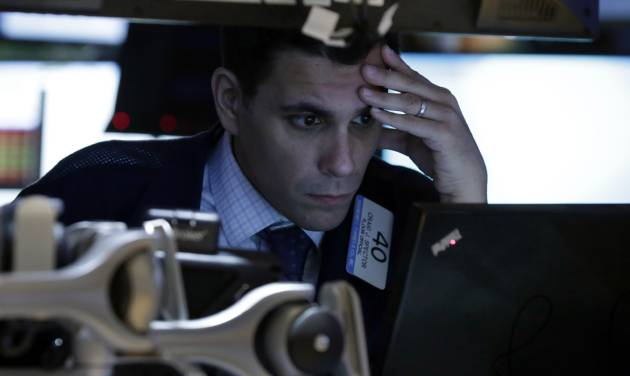 FILE - In this Monday, March 3, 2014, file photo, trader Craig Spector works on the floor of the New York Stock Exchange. (AP Photo/Richard Drew, File)