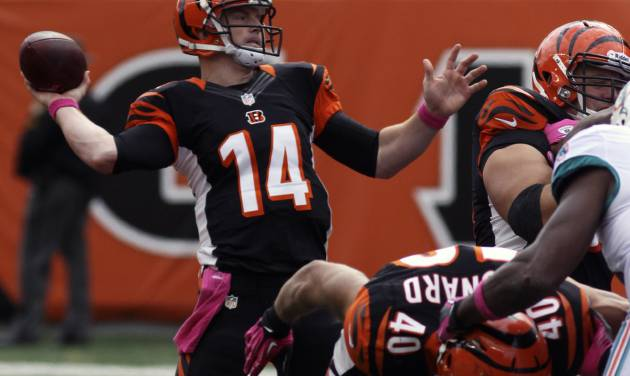 Cincinnati Bengals quarterback Andy Dalton (14) passes against the Miami Dolphins in the second half of an NFL football game on Sunday, Oct. 7, 2012, in Cincinnati. (AP Photo/Tom Uhlman)
