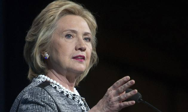 """FILE - This May 14, 2014, file photo shows former Secretary of State Hillary Rodham Clinton speaking in Washington. Clinton says she feels emboldened to run for president because of Republican criticism of her handling of the deadly 2012 terrorist attacks in Benghazi, Libya. Clinton says in an interview with ABC News airing June 9 that she remains undecided about another campaign in 2016. But she says the GOP-led Benghazi inquiry is """"more of a reason to run"""" because she considers the multiple investigations into the attacks """"minor league ball"""" for a country of the United States' stature. (AP Photo/Cliff Owen, File)"""