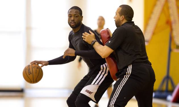 Miami Heat's Dwyane Wade, left, runs drills against David Fizdale during the team's practice session Sunday, May 5, 2013, as The Heat prepares to play the Chicago Bull in the upcoming NBA bsketball playoff series, in Miami. (AP Photo/J Pat Carter)