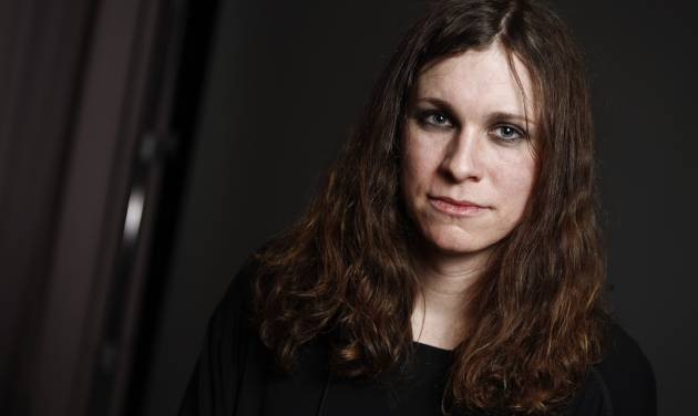 """FILE - This Jan. 10, 2014 file photo shows Laura Jane Grace, formerly known as Tom Gabel, of the band Against Me!, in New York. Grace, 33, publicly came out as transgender in 2012. She was born Tom Gabel and performed with the Florida-based band since 1997. At 6-2, with a mostly black wardrobe worthy of a rocker, Grace recalls the days before she was """"out"""" and on the hunt for women's clothes. Grace said she usually shops online, shares a shoe size with her wife (a women's 10) and picks up specialty pieces in boutiques during road trips with the band that last for weeks. (Photo by Brian Ach/Invision/AP, File)"""